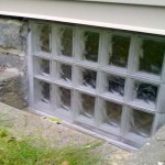 Bigger-Glass-Block-Basement-window-in-cement-well-compressor