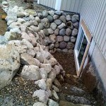 Custom Built Stone Egress Well With Built in Steps
